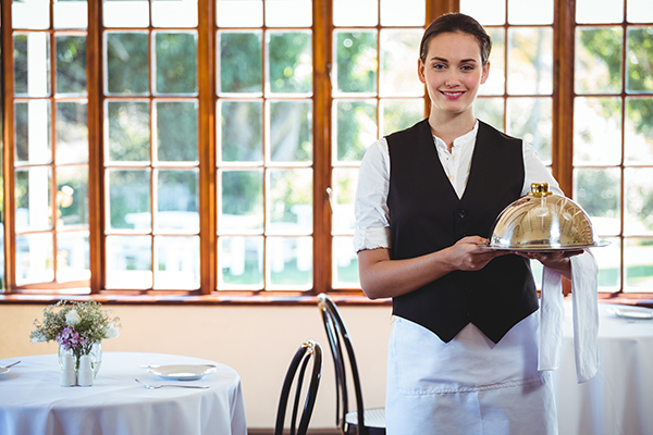 Waitress bringing food to table