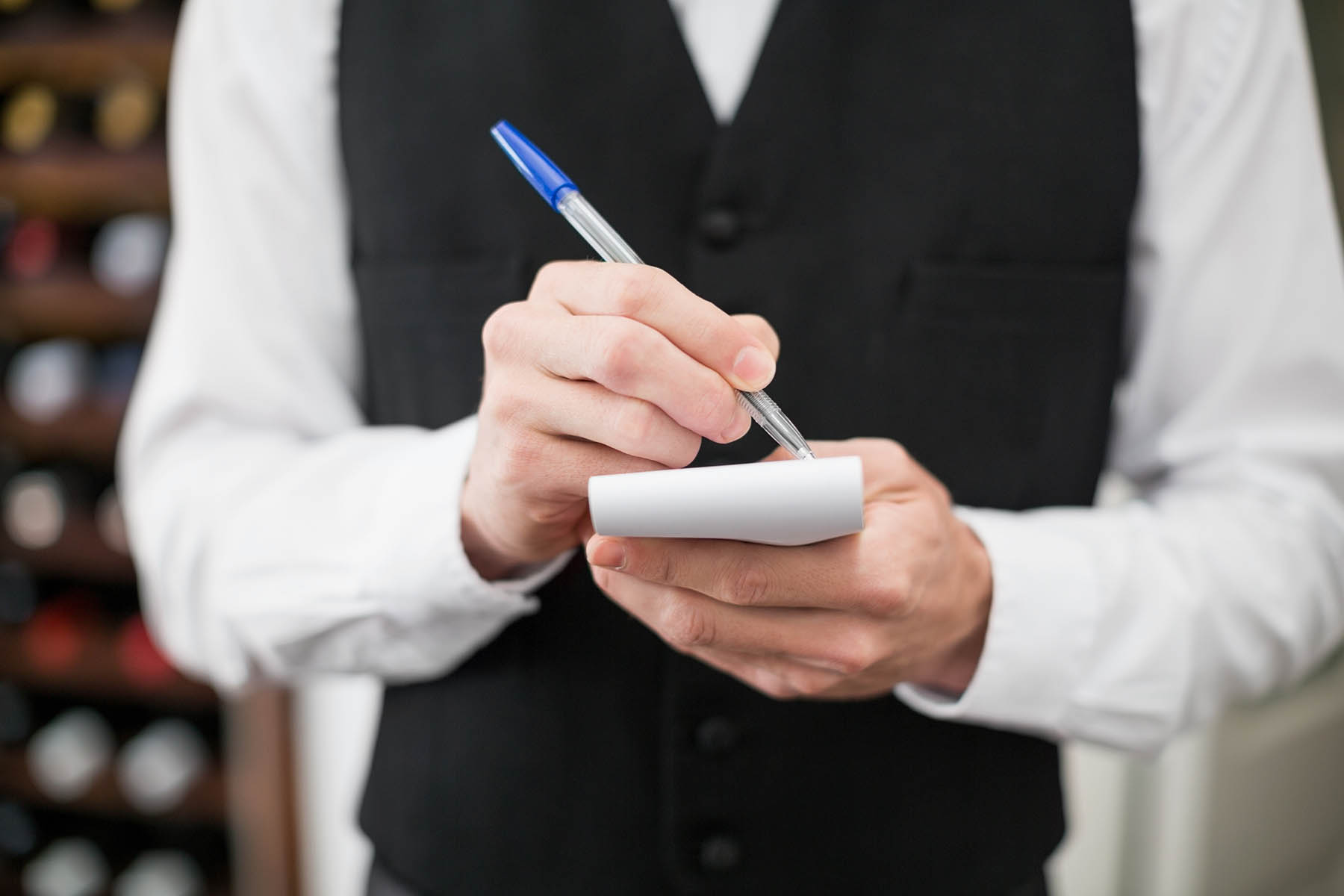 Image of a waiter taking an order